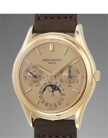 Patek Philippe - An exceedingly rare and incredibly attractive yellow gold perpetual calendar wristwatch with champagne dial and moonphases