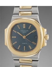 Patek Philippe - A very attractive stainless steel and yellow gold wristwatch with date, sweep center seconds and bracelet, retailed by Gübelin