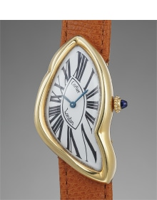 Cartier - A highly rare and attractive asymmetric yellow gold wristwatch with presentation box