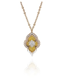 Van Cleef & Arpels - A Diamond, Colored Diamond and Gold Necklace and Pendant/Brooch