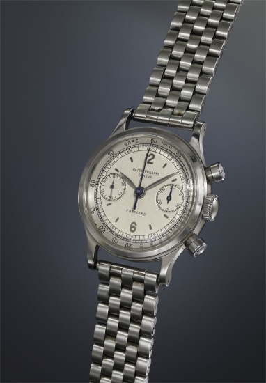An extremely rare and highly attractive stainless steel chronograph wristwatch with two-tone silvered dial, applied Arabic and baton hour markers, outer tachometer scale and bracelet, retailed by Freccero.