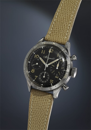 A very attractive and extremely rare stainless steel chronograph wristwatch with black dial and rotating bezel.