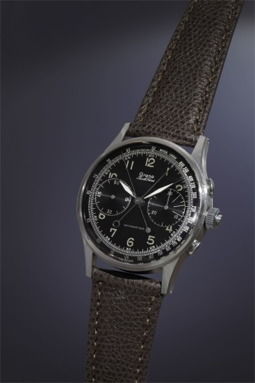 An extremely rare, attractive and large stainless steel split-seconds pilot's chronograph with black lacquer dial and outer tachometer scale.