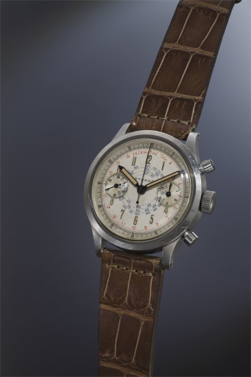 An attractive and large stainless steel chronograph wristwatch with silvered dial, telemeter and tachometer scales