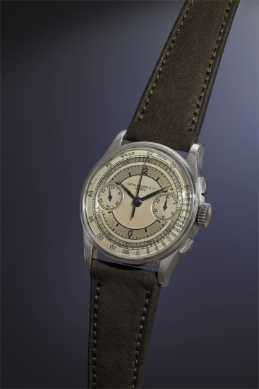 An extremely rare, highly attractive and important stainless steel chronograph wristwatch with multi-tone silvered sector dial, black enamel Arabic and baton hour markers, and tachometer scale.
