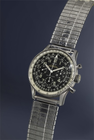 """A very rare, highly attractive and early stainless steel pilot's chronograph wristwatch with black dial, """"beads of rice"""" slide rule bezel, and expandable bracelet."""