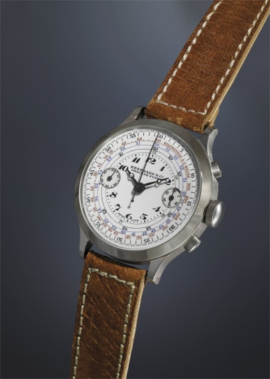 A very rare, attractive and oversized stainless steel chronograph wristwatch with enamel dial and multi-colored tachometer scales.