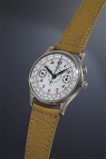 A very fine and rare stainless steel chronograph wristwatch with enamel dial and three-colored tachometer scale.