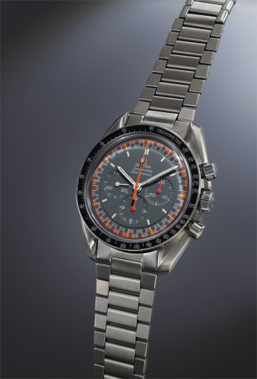 """An attractive and rare stainless steel chronograph wristwatch with black """"racing"""" dial, luminous indexes, tachometer bezel, and bracelet."""