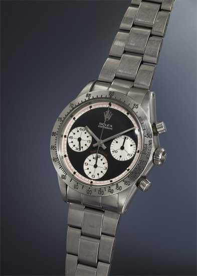 """An extremely rare and highly attractive stainless steel chronograph wristwatch with """"flying saucer"""" black dial and bracelet, accompanied by original Rolex guarantee and presentation box."""