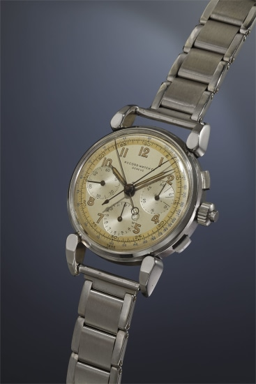 A very rare, highly attractive and large stainless steel split-seconds chronograph wristwatch with three-tone silvered dial, fancy lugs and bracelet.