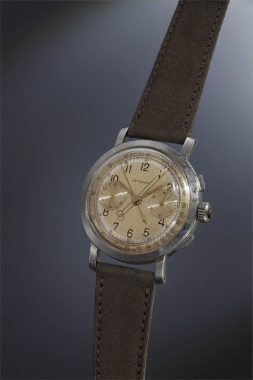 A very rare, highly attractive and large stainless steel split-seconds chronograph wristwatch with rose and off-white two-tone dial.