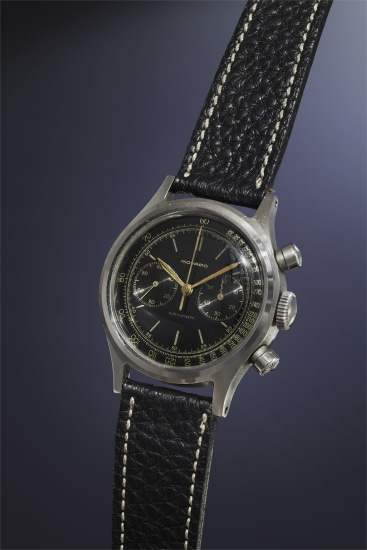 A highly attractive and very rare stainless steel chronograph wristwatch with black lacquered dial and gold-colored tachometer scale