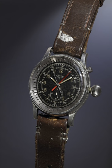 A very rare, important and oversized stainless steel single-button fly-back aviator's chronograph wristwatch with black dial, large crown and revolving bezel.