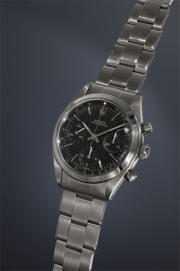 An extremely rare and attractive stainless steel chronograph wristwatch with black dial and bracelet, accompanied by presentation box and guarantee.