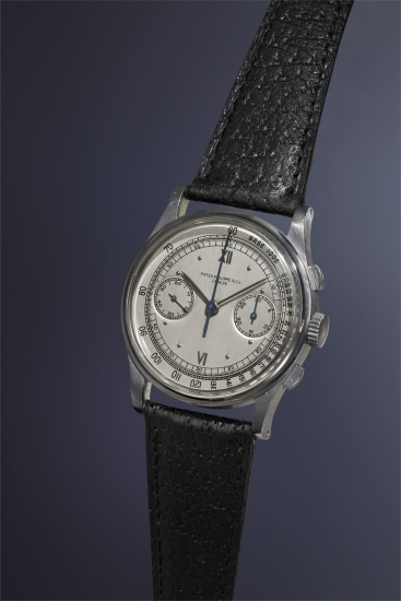An extremely rare, important, attractive and large stainless steel chronograph wristwatch with silvered dial, tachometer scale and applied Roman and dot hour markers.