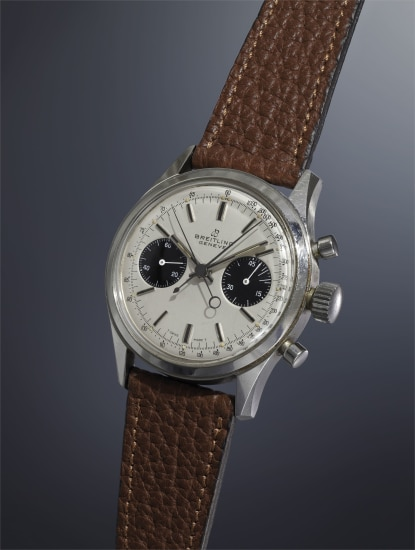 A very fine, rare and oversized stainless steel split-seconds chronograph wristwatch with silvered dial, applied hour markers and tachometer scale.