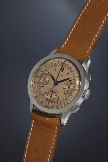 An extremely rare, attractive and large stainless steel antimagnetic chronograph wristwatch with salmon colored dial, tachometer and telemeter scales.