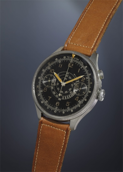 A very rare and oversized stainless steel pilot's single-button chronograph wristwatch with black dial, rotatable bezel with triangular shaped luminous markers, tachometer and telemeter scales.