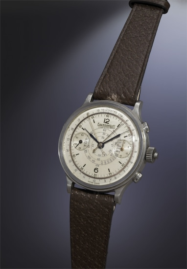 A very rare, attractive and oversized stainless steel split-seconds chronograph wristwatch with silvered dial with copper ring, telemeter scale and snail-shaped tachometer scale.
