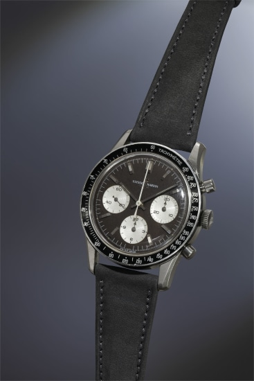 A very attractive, rare and large stainless steel chronograph wristwatch with tropical black dial and tachometer bezel