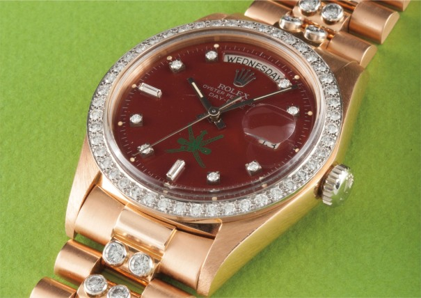 "A very rare and important pink gold and diamond-set calendar wristwatch with bracelet, centre seconds, burgundy lacquered ""Stella"" dial, made for the Sultanate of Oman"