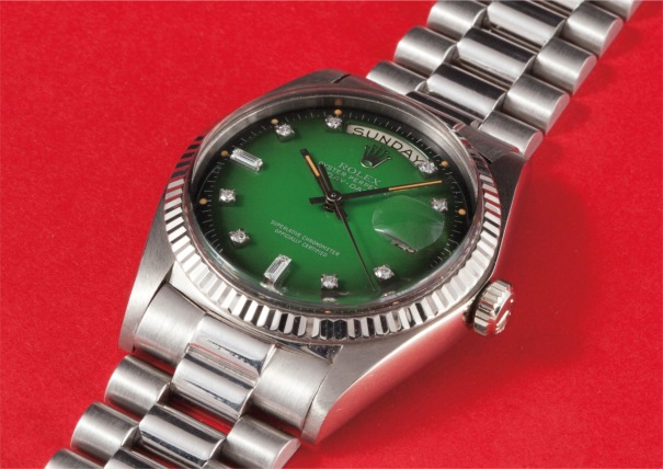 A rare and attractive white gold and diamond-set calendar wristwatch with bracelet, centre seconds and green dégradé dial