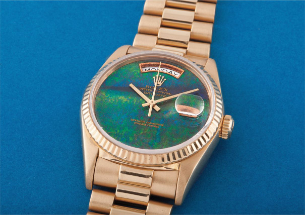 A very rare and unusual yellow gold calendar wristwatch with centre seconds, bracelet and opal hard stone dial