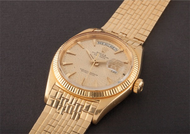 A very rare and early yellow gold calendar wristwatch with unusual big logo bracelet, centre seconds and geometric engine turned dial