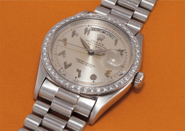 A very rare and important platinum and diamond-set wristwatch with Arabic calendar, applied white gold Arabic numerals, centre seconds and bracelet