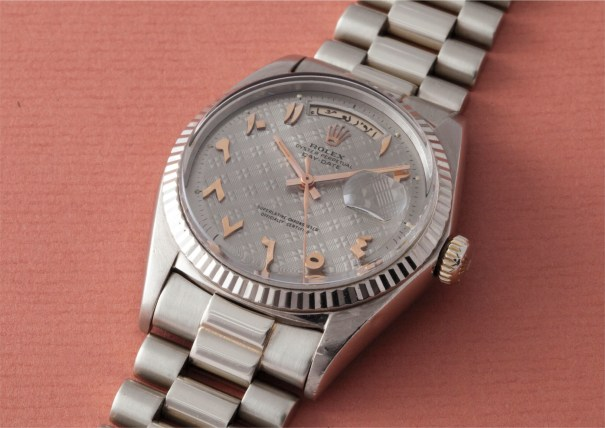 An extremely rare and highly important white gold wristwatch with Arabic calendar, pink gold applied Arabic numerals, centre seconds, bracelet and unusual tapisserie dial