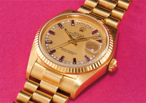 A rare and attractive yellow gold, diamond and ruby-set calendar wristwatch with centre seconds, bracelet and champagne dial