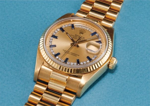 A rare and attractive yellow gold, diamond and sapphire-set calendar wristwatch with centre seconds, bracelet and champagne dial