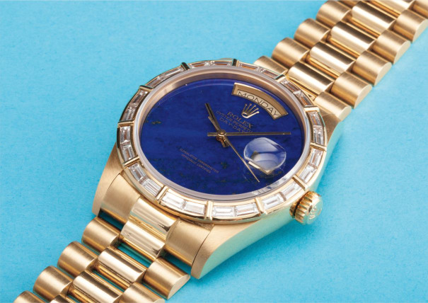 A very rare and attractive yellow gold and baguette diamond calendar wristwatch with bracelet, centre seconds and lapis lazuli hard stone dial