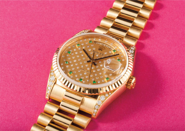 A very rare and beautiful yellow gold, diamond and emerald-set calendar wristwatch with bracelet and centre seconds