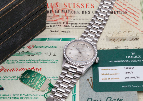 A very rare platinum and diamond-set calendar wristwatch with centre seconds, bracelet, rate certificate, guarantee, day-date booklet, swing tags and unusual presentation box