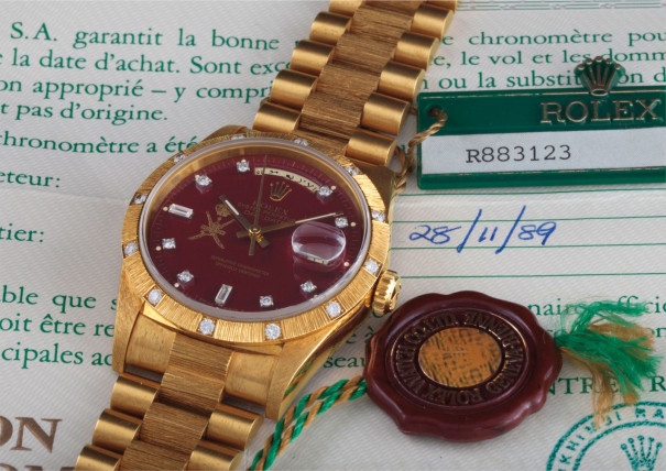 """A very rare and possibly unique yellow gold and diamond-set wristwatch with Arabic calendar, bracelet, centre seconds, burgundy lacquered """"Stella"""" dial, original guarantee, swing tags, made for the Sultanate of Oman"""