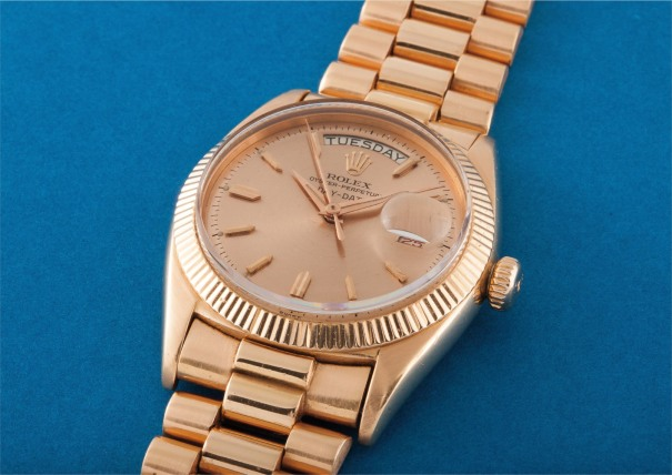 An extremely rare and historically important pink gold calendar wristwatch with centre seconds, red and black date, bracelet and pink dial with no chronometer certification