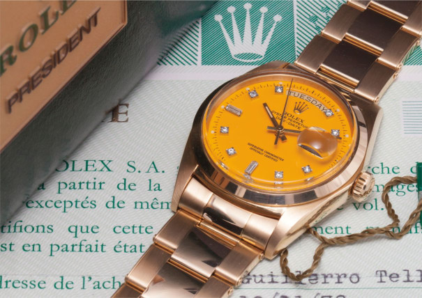 """A very rare and attractive yellow gold and diamonds calendar wristwatch with bracelet, centre seconds, yellow lacquered """"Stella"""" dial, guarantee and box"""