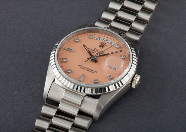 """A very rare and attractive white gold and diamond-set calendar wristwatch with centre seconds, bracelet and pink lacquered """"Stella"""" dial"""