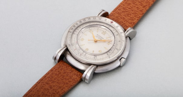 A highly unusual, extremely rare and oversized stainless steel wristwatch with slide rule