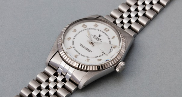 A very rare and attractive stainless steel wristwatch with white enamel coated dial, date, and bracelet