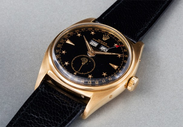 "An extremely rare, highly attractive and important yellow gold triple calendar wristwatch with moonphases, and black lacquer ""star-dial"""
