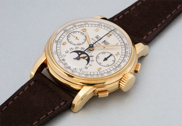 An extremely rare and highly important yellow gold perpetual calendar chronograph wristwatch with moon phases and applied Arabic numerals