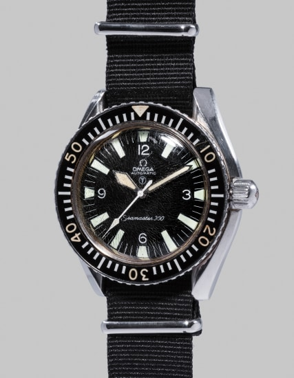 A very rare, attractive and large stainless steel divers wristwatch with center seconds, fixed spring bars and special military markings, made for the British Royal Navy