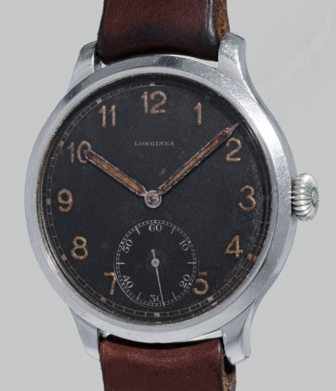 An oversized military-type stainless steel wristwatch with black dial, luminous hour markers and hands