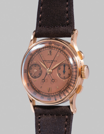 An extremely fine and rare pink gold split seconds chronograph wristwatch with pink dial, original certificate, envelope, invoice and presentation box