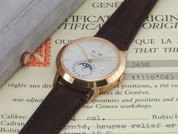 An exceptional and very rare yellow gold perpetual calendar wristwatch with moon phases, Roman leap year indicator, original certificate and box