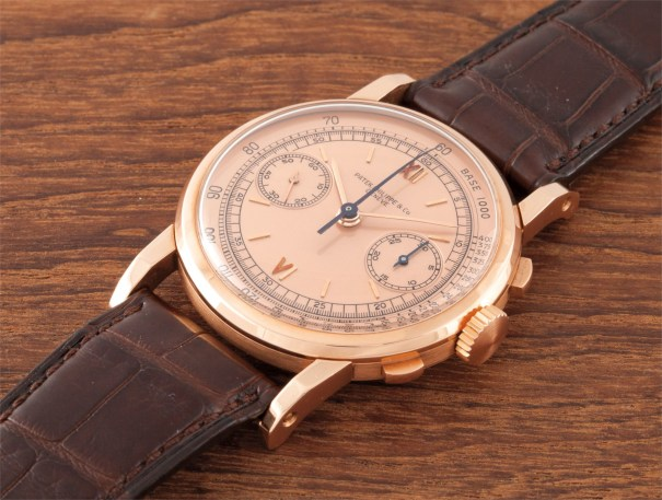 An extremely rare and important oversized pink gold chronograph wristwatch with pink dial and faceted elongated lugs