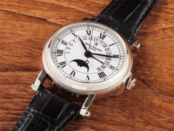 A fine and rare white gold perpetual calendar wristwatch with centre seconds and retrograde date